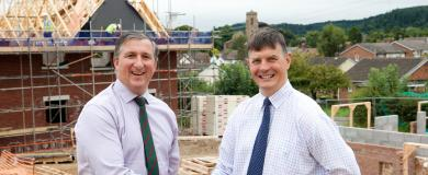Family businesses work together for village homes scheme