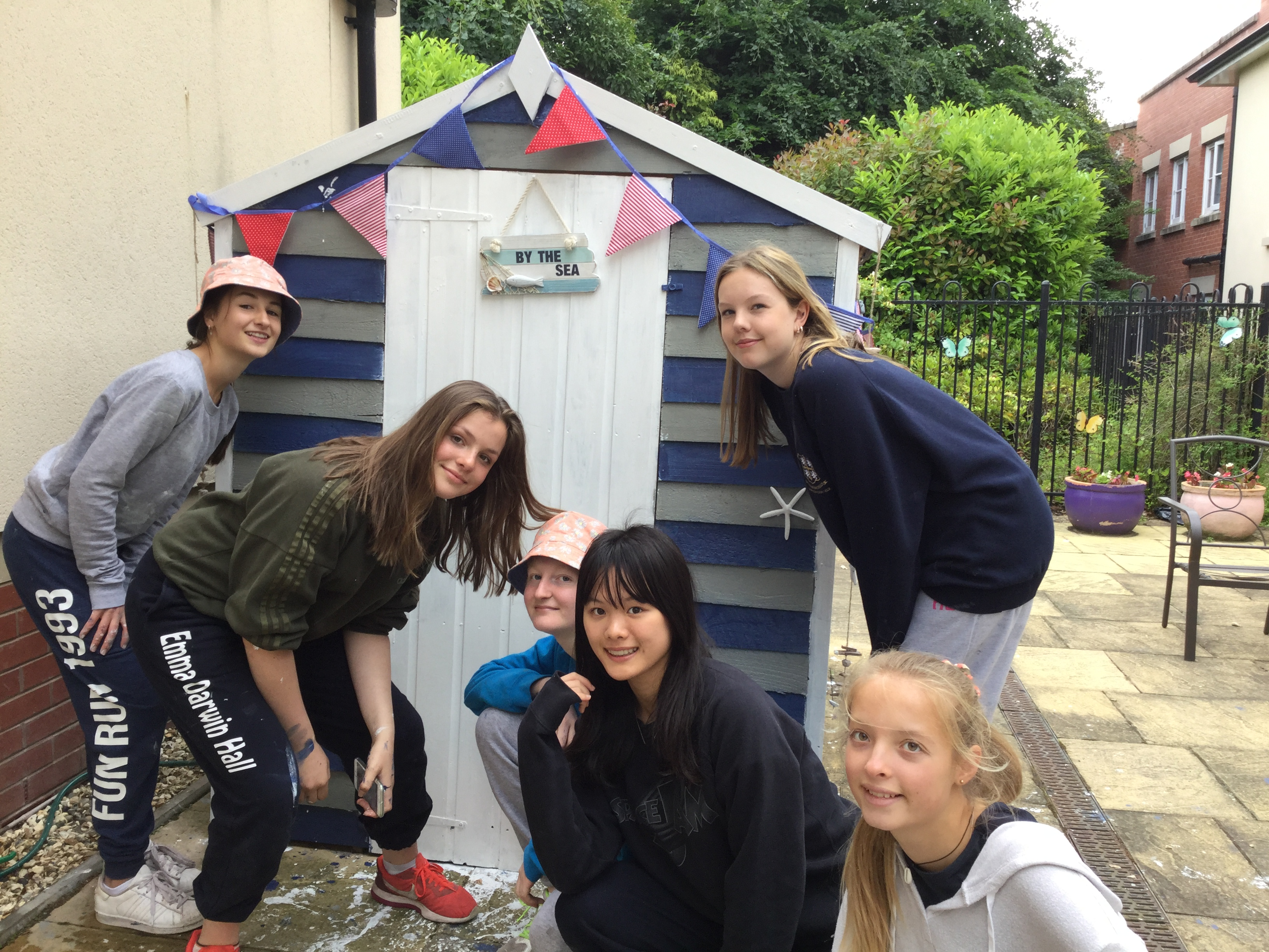 Students lead shed makeover for care home residents